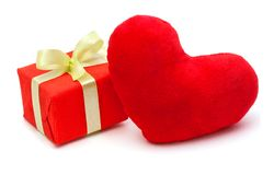 Red gift box with a textile red heart Stock Photos