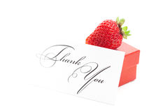 Red gift box, thank you card and strawberries Stock Photo