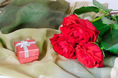 Red gift box and three red roses Royalty Free Stock Photos