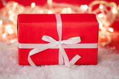 Red Gift Box Tied With White Ribbon Stock Photo