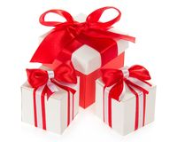 Red gift box and two white boxes Stock Photos