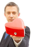 Red gift box for valentine. Handsome man holding a red gift box fot valentine Stock Images