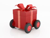 Red gift box on wheels Stock Photography