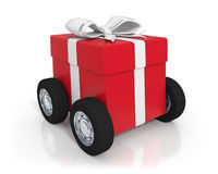Red gift box with wheels Stock Images