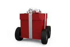 Red gift box on wheels Stock Photos