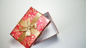 Red gift box on white background.  Stock Photo