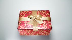 Red gift box on white background.  Royalty Free Stock Photography
