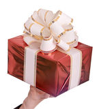 Red gift box and white bow. Royalty Free Stock Image