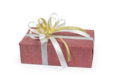 Red gift box with white and gold ribbons bow. On white backgound Royalty Free Stock Photos