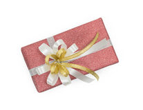 Red gift box with white and gold ribbons bow. On white backgound Royalty Free Stock Photography