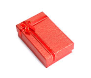 Red gift box with white red ribbon bow isolated on white backgro. Und stock images