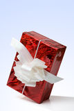 Red gift box with a white ribbon Royalty Free Stock Photos