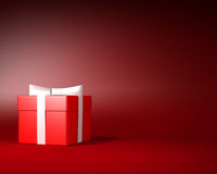 Red Gift Box with White Ribbon and Bow on the Red Background Royalty Free Stock Image