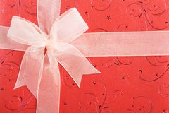 Red gift box with white ribbon Stock Photo