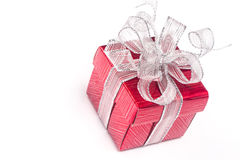 Red gift box with white ribbon isolated on white background. Cli Royalty Free Stock Photo