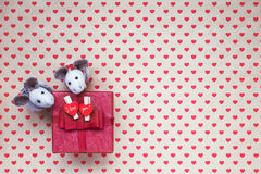 Red Gift Box With Hearts On Hearts Background. Stock Photography