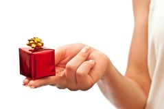 Red gift box in woman's hand Royalty Free Stock Image