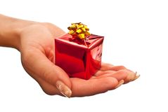 Red gift box in woman's hand Royalty Free Stock Images