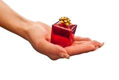 Red gift box in woman's hand Stock Image