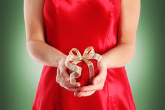 Red gift box in woman's hands Royalty Free Stock Photos