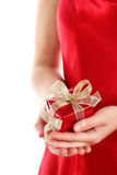 Red gift box in woman's hands Stock Photography