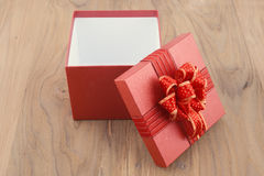Red Gift box on wood for anniversaries Stock Photography