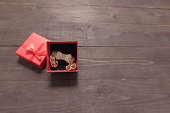 Red gift box is on the wooden background with empty space Stock Photo