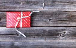 Red gift box on wooden background. Red gift box on a wooden background stock photography