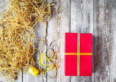 Red gift box on wooden background with ribbons Royalty Free Stock Image