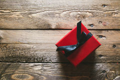 Red Gift box, on wooden table Royalty Free Stock Photos