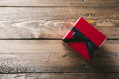 Red Gift box, on wooden table Stock Images