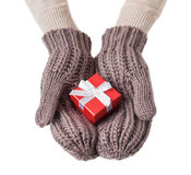 Red gift box in wool gloves Royalty Free Stock Image