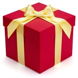 Red gift box with yellow ribbon and bow. Royalty Free Stock Photography