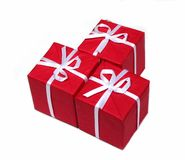 Red gift boxes. Three bright red gift boxes isolated on white background Stock Photos