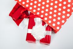 Red gift boxes and and christmas hat in shopping bags Royalty Free Stock Image