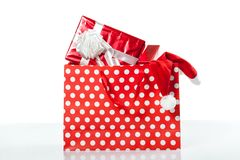 Red gift boxes and and christmas hat in shopping bags Stock Photo