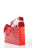 Red gift boxes and and christmas hat in shopping bags Royalty Free Stock Photos