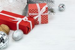 Red gift boxes with christmas tree decorations and fir tree bran Royalty Free Stock Images
