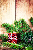 Red Gift Boxes and fir tree branch on rustic wood background wit Stock Photos