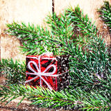 Red Gift Boxes and fir tree branch on rustic wood background wit Stock Images