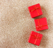 Red gift boxes on glitter gold background Stock Image