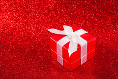 Red gift boxes on glitter red background Stock Photos