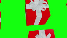 Red Gift boxes on a green stock video footage