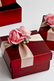 Gift boxes. Red gift boxes with pink flowers Stock Photos