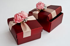 Gift boxes. Red gift boxes with pink flowers Royalty Free Stock Images
