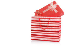 Red gift boxes in red shopping bag Royalty Free Stock Photo