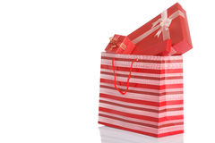 Red gift boxes in red shopping bag Stock Photos