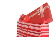 Red gift boxes in red shopping bag Royalty Free Stock Image