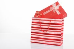 Red gift boxes in red shopping bag Stock Image