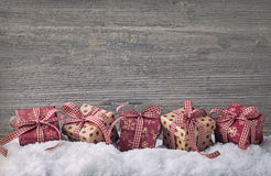 Red gift boxes. On snow Royalty Free Stock Images